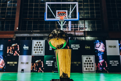 NBA Winners' Corner presented by OLG, a 13,000 square-foot fan experience in Toronto, features a half-court basketball court, iconic imagery from NBA Finals and an immersive mirror room featuring the Larry O'Brien Championship Trophy. (CNW Group/OLG)