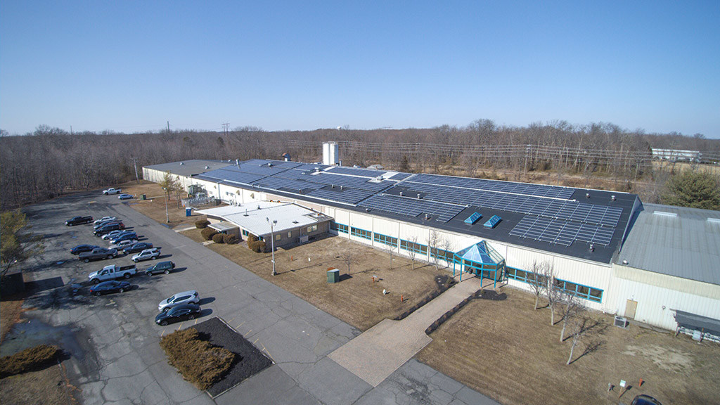 1,566 high efficiency solar panels were installed on the roof of the 140,000 sq. ft. manufacturing plant
