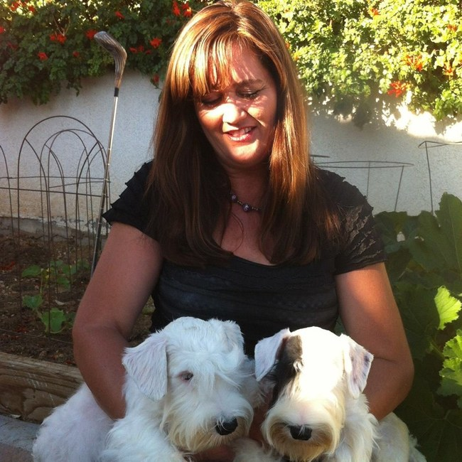 Principal owner Lisa Inman Lee with two of her prized Sealyhams
