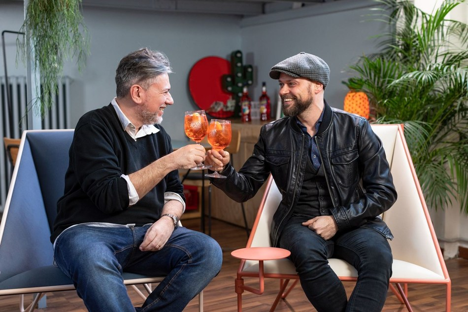 Sergio Gerasi and Tito Faraci discussing their graphic novel 'Orange Chronicles' celebrating 100 years of joyful connections sparked with Aperol (PRNewsfoto/Aperol)