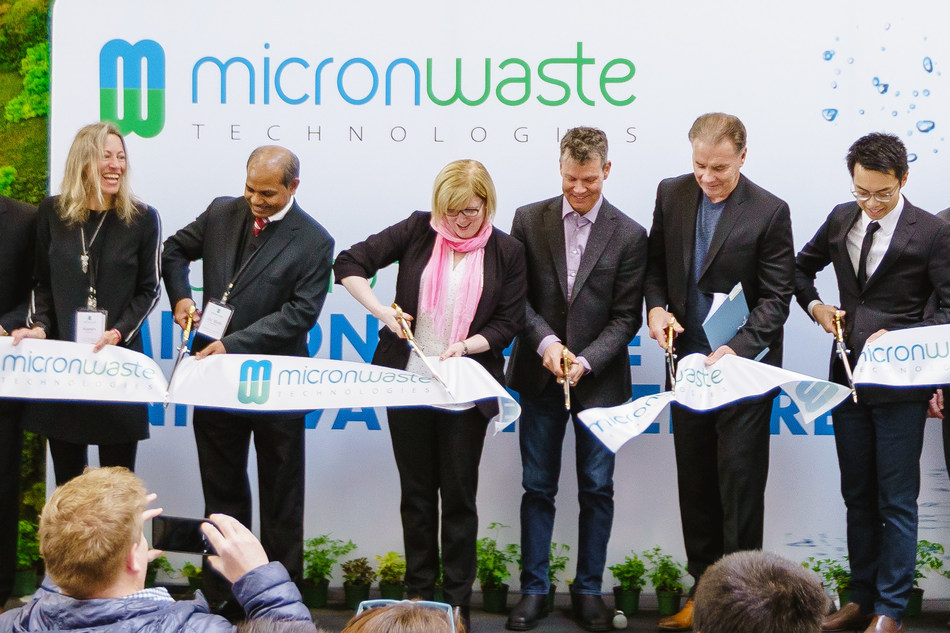 Ribbon cutting ceremony at the Micron Waste Innovation Centre official opening (left to right: Karen Lauriston, Micron VP Corporate; Dr. Bob Bhushan, Micron Chief Technology Officer; Hon. Carla Qualtrough, Minister for Public Services and Procurement; Cam Battley, CCO, Aurora Cannabis and Micron Board Member; Alfred Wong, Micron President & CEO) (CNW Group/Micron Waste Technologies Inc.)
