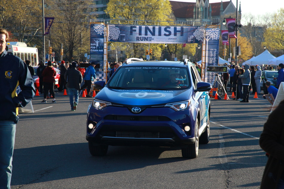 Toyota Hybrids' pace vehicle leads runners to the finish of Clean Air Council's Run for Clean Air.