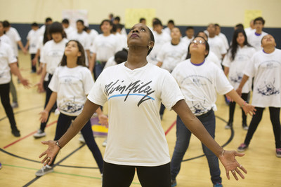 """Nasha Thomas leads students in an Ailey """"Revelations"""" Residency at Washington Carver Middle School, the school Alvin Ailey attended. Photo by Drew A. Kelley."""