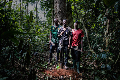 Local villagers stand near a freshly planted Ebony seedling in Cameroon's Congo Basin rainforest as part of TaylorGuitars' The Ebony Project. Photo credit: Chris Sorenson/Taylor Guitars.