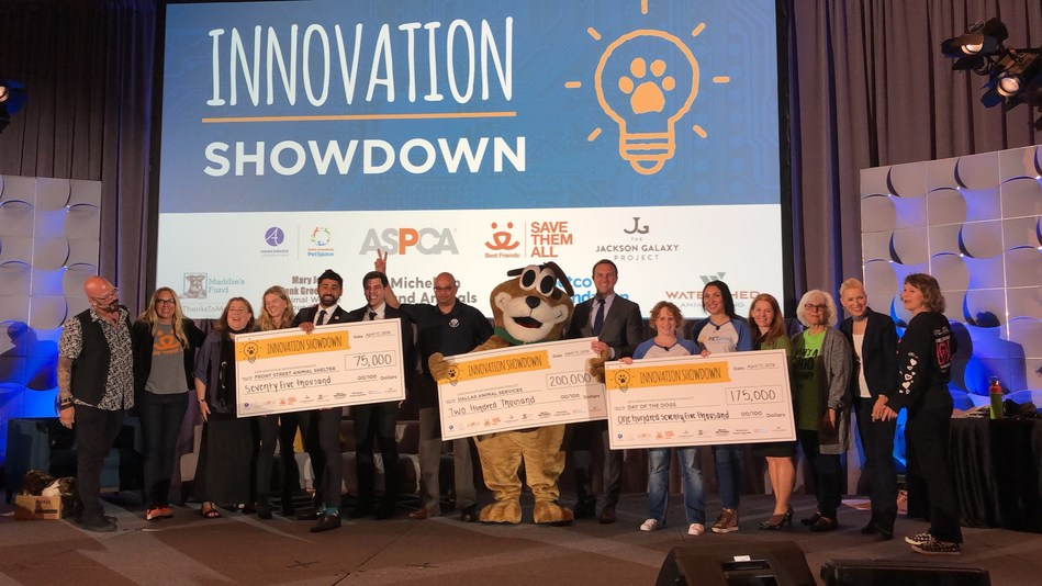 The judging panel of Innovation Investors along with the 2019 Innovation Showdown winners on stage at HSUS Animal Care Expo.