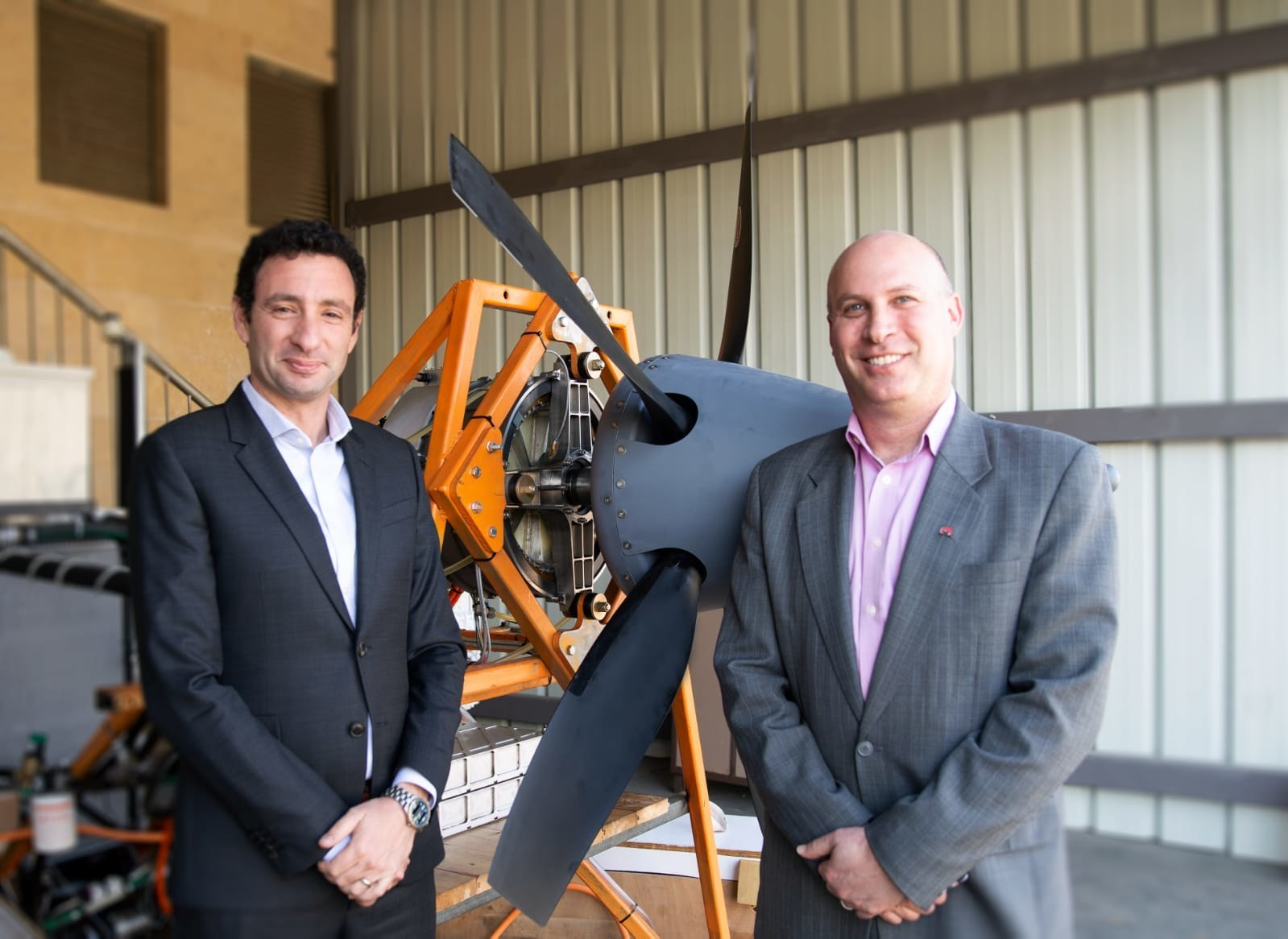 Eviation selects electric propulsion leader magniX to support development of first all-electric plane. Pictured above: Eviation CEO, Omer Bar-Yohay, with magniX CEO, Roei Ganzarski, presenting a magniX motor, which requires no fuel and produces no greenhouse gases.
