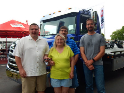 Hino Trucks & Miller Industries Representatives hand over the keys to a new 2019MY truck to Lynn Hope Towing!