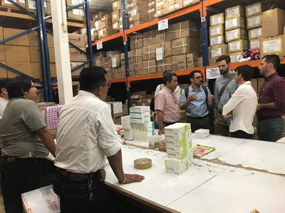 PATH's Market Dynamics team, with partners Medicines for Malaria Ventures and Global Health Strategies, visit a central warehouse in Iquitos, Peru to learn about the country's public health procurement and supply chain systems. Photo: PATH.