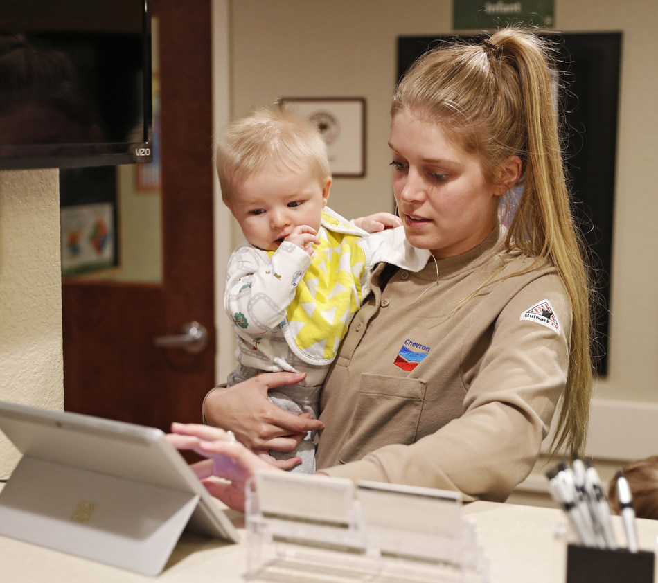 Chevron U.S.A. employee Holly Anderson checks in her son at Primrose School of Midland at Westridge. The recent opening of this new employer-sponsored school marks a collaboration between Primrose on Premise® and four major oil companies in Midland, TX. Primrose School of Midland at Westridge offers support for working parents by providing high-quality early education and care for their children. (Brad Tollefson/AP Images for Primrose Schools)