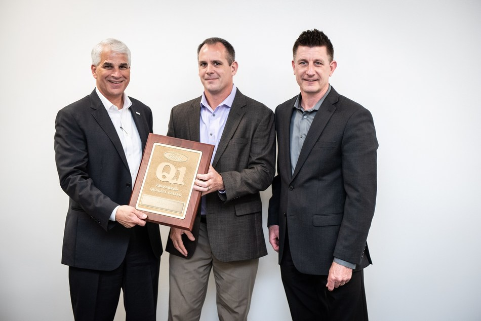 Tom Ludwig, STA Site Supervisor Ford, presents the Ford Q1 Certification plaque to Bill Hunter, General Manager Brose New Boston, and Darrell Herrick, Vice President Quality Brose North America.