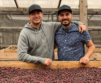 Martin Mayorga (left) from Mayorga Organics visits Max Perez (right) from the farm La Hermosa Coffee while sourcing coffee in Acatenango Valley, Guatemala. Together, they inspect harvested coffee cherries drying on raised beds, before the fruit is removed and the resulting coffee beans packed, stored, and eventually transported. Credit: Mayorga Organics