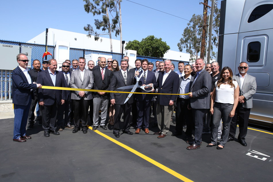 Penske celebrating the announcement of its new electric vehicle commercial charging capabilities at its La Mirada, CA, facility during a livestream ribbon-cutting event with the Advanced Clean Transportation Expo in Long Beach, California, April 24, 2019.