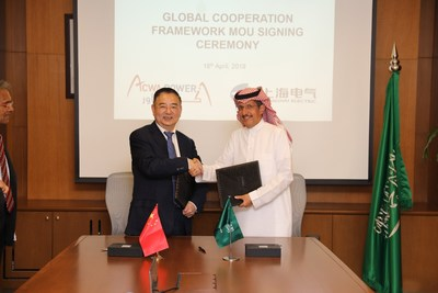 Yi Xiaorong (left), the vice president of Shanghai Electric and Muhammed A.Abunayyan (right), the Chairman of ACWA Power
