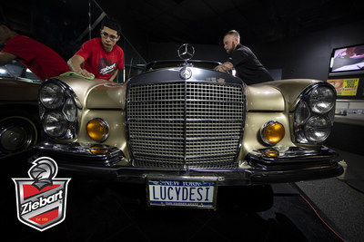Ziebart of Jamestown owner, Kyle Crandall (right), and his associate, Jesus Robles (left), worked to restore the exterior of Lucille Ball's 1972 Mercedes-Benz 280 SE.