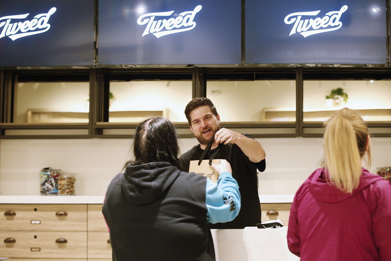 A Tweed employee packages product for a customer at the Tweed store in Portage la Prairie, MB, Friday, April 26, 2019, the day the store opened to the public. (CNW Group/Tweed)