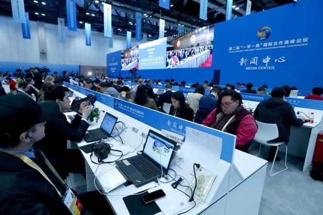 Reporters from around the world watch Xi's keynote speech at the media center of the Second Belt and Road Forum for International Cooperation in Beijing on April 26, 2019. [Photo by Zhu Xingxin/China Daily]
