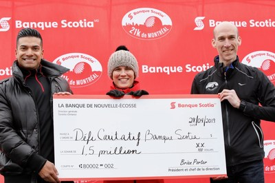 Scotiabank's  Jean Pierre Sanchez and Guylaine Duplessis from Scotiabank and François Lecot, Banque Scotia 21k de Montréal Race Director unveil the new Scotiabank Charity Challenge fundraising total, a new record – $1.5 million in support of 80 local charities.  Credit: Todd Fraser (CNW Group/Scotiabank)