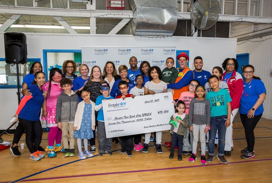 Empire BlueCross BlueShield staff presents YMCA staff and kids at the Bronx YMCA with a $75,000 grant for children's health. (Photo Credit: Christopher Ernst)