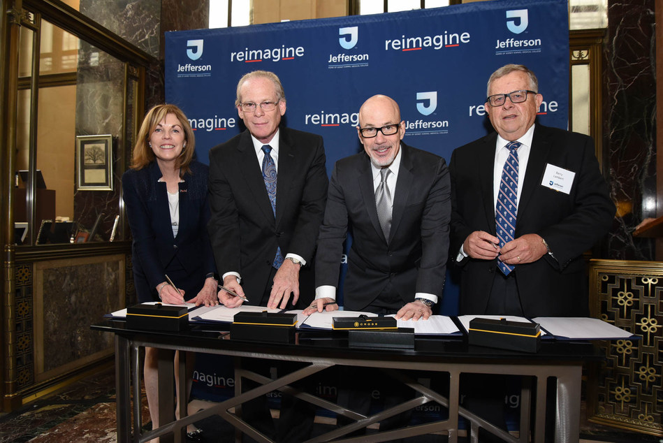Elizabeth Dale, EdD; Larry Merlis; Stephen Klasko, MD, MBA; and Barry Lambert pose for a photograph during an official signing ceremony at Jefferson.