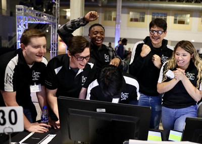During the 7th annual Magnetar Team Challenge, high school teams built $100,000 mock stock portfolios and managed them through two hour-long trading periods. Here, the Chicago High School for Agricultural Sciences team - who placed second - celebrates after receiving a profit and loss update.