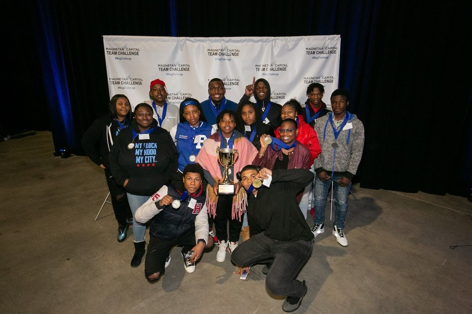 Wendell Phillips Academy High School students – the winners of the 7th annual Magnetar Team Challenge mock stock trading and financial education competition – pose with their first place trophy and medals.