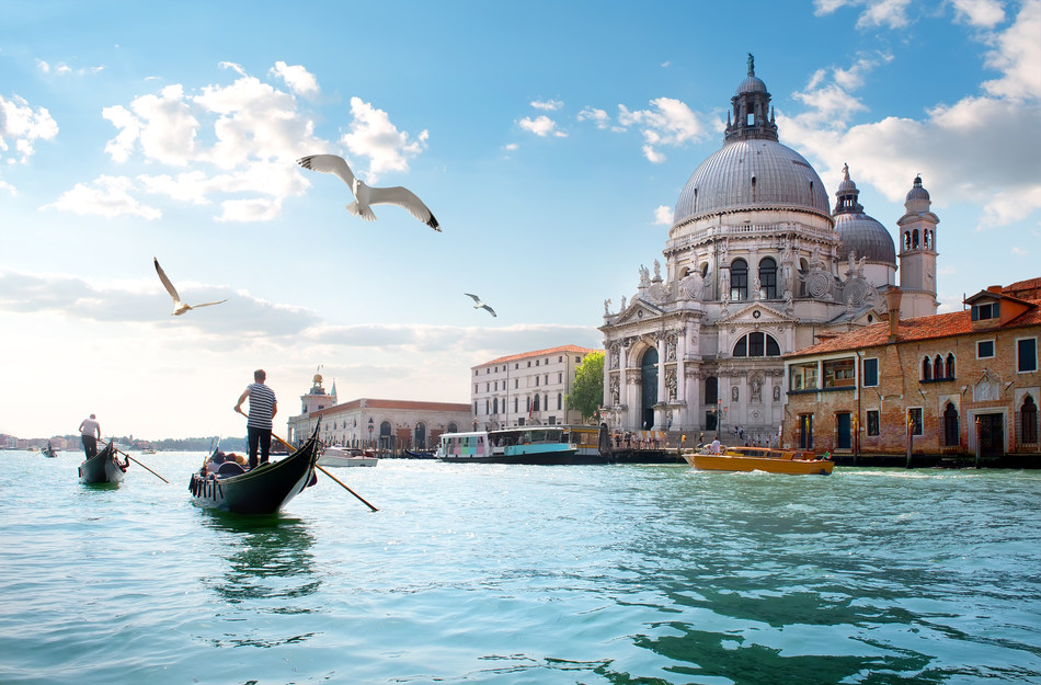 The famous Grand Canal of Venice and iconic gondolas are one of Europe's extraordinary sights, and easily accessible by cruise ship. Photo courtesy of Holland America Line