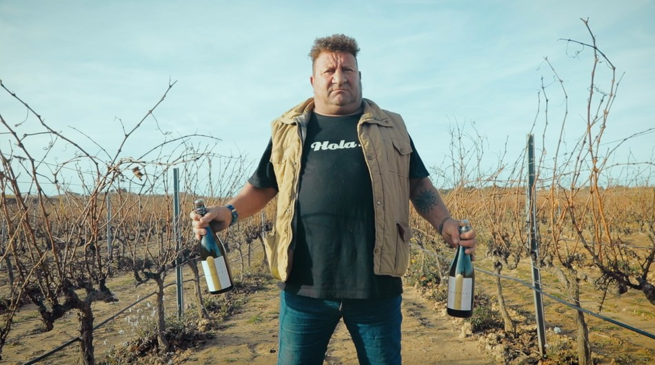 Manel, a local producer is holding the Boycott-free cava with one foot stepping on Catalonia and the other one in Spain. He lives in a village which has vineyards in both sides of the border. Like him, hundreds of other local producers have been affected by the boycott. (PRNewsfoto/MRM Madrid)