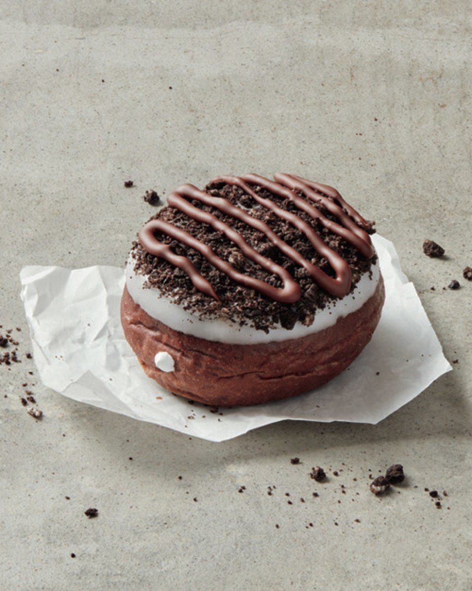 The OREO® infused donut is delicious chocolate donut with vanilla filling dipped in white fondant and OREO® crumbs, topped with drizzled chocolate fondant (CNW Group/Tim Hortons)