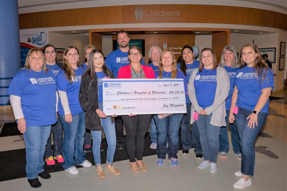 """Associates from Landmark Credit Union presented a check for more than $45,000 to Mary Piwaron of Children's Hospital of Wisconsin. The funds were raised during Landmark's annual """"Link up for Children"""" campaign. In addition, the associates volunteered their time to create 1,500 card making kits for patients and their families."""
