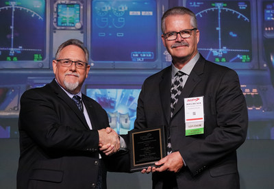 Lou Dorworth (left), co-chair of the SME Composites Manufacturing Technical Group, presents Douglas Decker (right), Technical Fellow, Northrop Grumman Corporation, with the 2019 J.H.