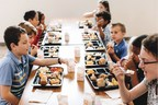 Picture of a table of kids eating lunch at school