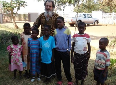 Carlo Spini working with children in Africa