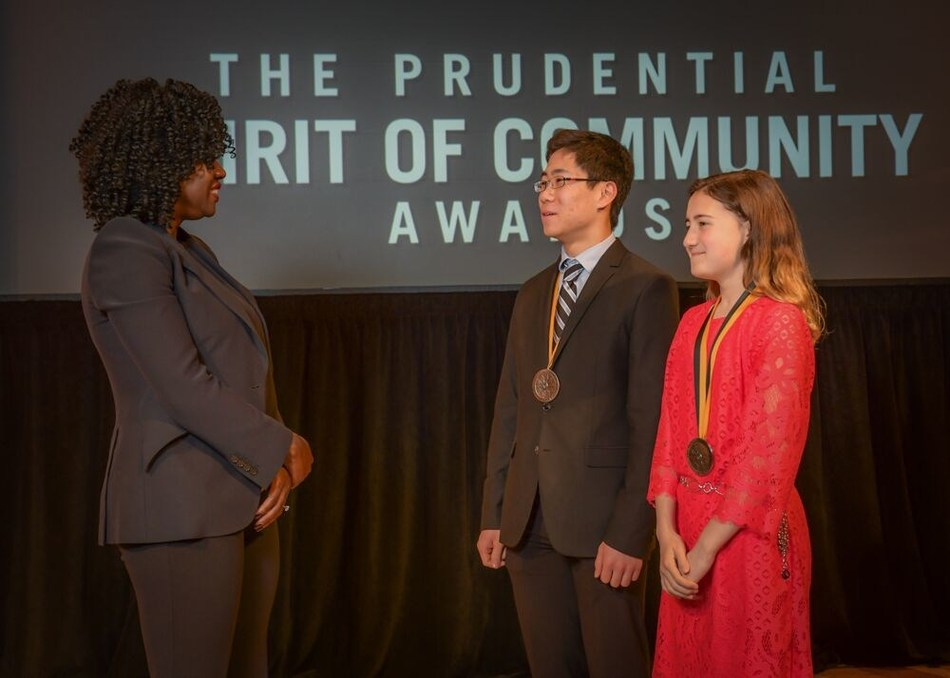 Award-winning actress Viola Davis congratulates Justin Hu, 16, of Vienna (center) and Shayla Young, 13, of Springfield (right) on being named Virginia's top two youth volunteers for 2019 by The Prudential Spirit of Community Awards. Justin and Shayla were honored at a ceremony on Sunday, May 5 at the Smithsonian's National Museum of Natural History, where they each received a $1,000 award.