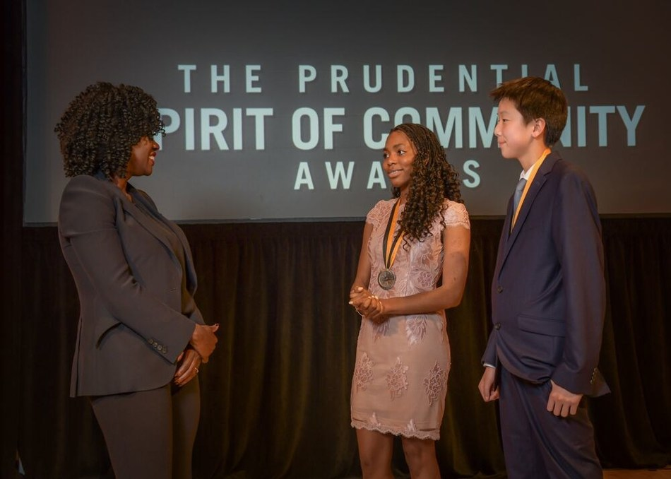 Award-winning actress Viola Davis congratulates Alexia Ayuk, 17, of Gaithersburg (center) and Caleb Oh, 14, of Gambrills (right) on being named Maryland's top two youth volunteers for 2019 by The Prudential Spirit of Community Awards. Alexia and Caleb were honored at a ceremony on Sunday, May 5 at the Smithsonian's National Museum of Natural History, where they each received a $1,000 award.