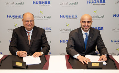 Pradman Kaul, President of Hughes, and Masood M. Sharif Mahmood, Yahsat's Chief Executive Officer, make the companies' new joint venture agreement official at SATELLITE 2019 in Washington, D.C.