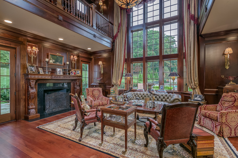 A spectacular, 2-story library features soaring windows, a fireplace lounge, large wet bar and direct access to the outdoor living areas. The library's design is influenced by the details of Lord Admiral Nelson's flagship HMS Victory. LigonierLuxuryAuction.com.