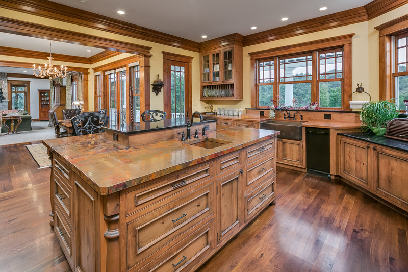 A gourmet kitchen includes top-of-the-line appliances, custom woodwork and plenty of natural light. It's conveniently situated between the formal dining room and breakfast area, and its large island provides added space for informal dining or wine tasting. LigonierLuxuryAuction.com.