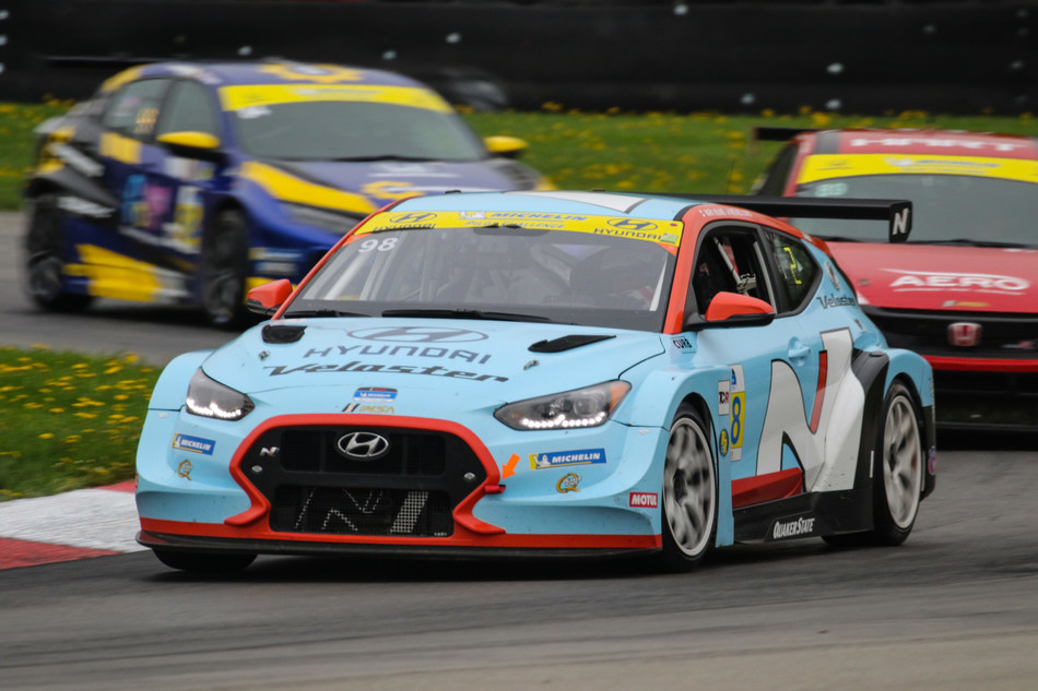 Michael Lewis and Mark Wilkins Win Wet and Wild Mid-Ohio 120. First IMSA victory for Bryan Herta Autosport and Hyundai.