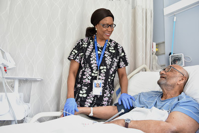 Humber River Hospital nurse, Virginia Dobson, visits with her patient, Walter Lachman, at the newly refurbished and modernized Reactivation Care Centre in Toronto. (CNW Group/Humber River Hospital)