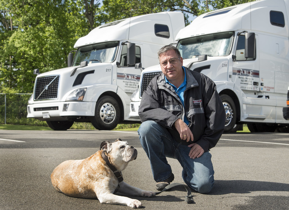 Bob Mulligan, Certified Moving Consultant at Able for 25 years, with his assistant Hank. Bob maintains the reason he has had so many repeat customers over the years is completely due to the operations department at Able, which he knows is the best in the business.