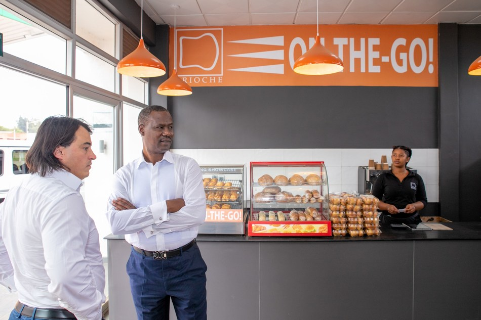 Yves Legrux, CEO of SP Ltd (l) and Egide Gatera, Founding Shareholder of SP Ltd (r) inspect the new Brioche On-The-Go! Convenience Retail Shop