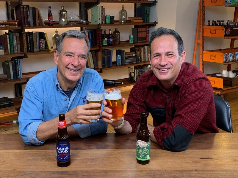 Jim Koch and Sam Calagione with their flagship beers.