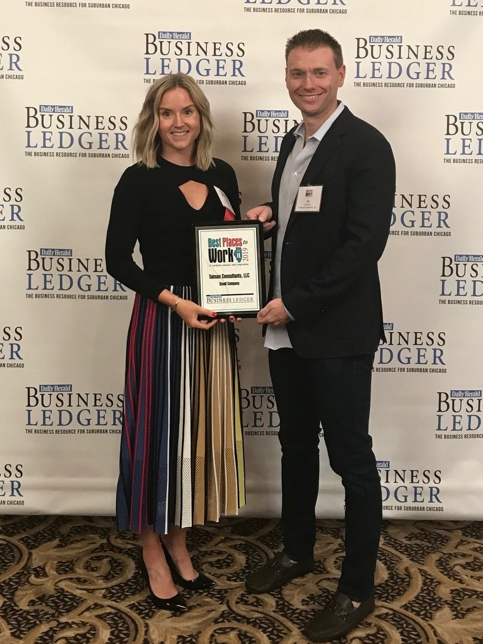 Katherine Latham, Managing Partner and James Norton, Partner, Talman Consultants, Accepting the 2019 Best Places to Work In Illinois Award
