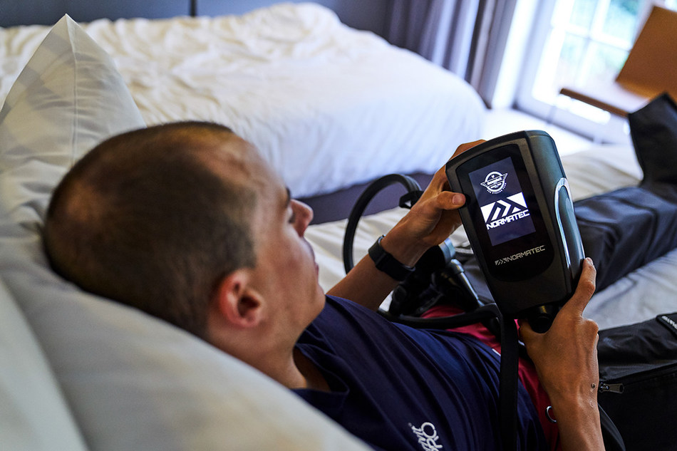 Deceuninck - Quick-Step rider Enric Mas recovers with NormaTec. Photography credits to Sigfrid Eggers