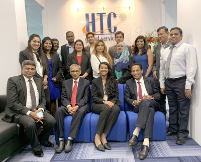 Chary Mudumby, Teja Reddy, Saji Abraham (seated) with HTC Global Services Malaysia Team