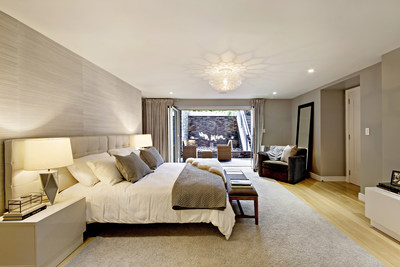 """The spacious master suite opens to the lower terrace, where features such as a rock garden, lounge seating and a fully-equipped outdoor kitchen – in addition to """"waterfall"""" and """"putting green"""" amenities – await. NewYorkLuxuryAuction.com"""