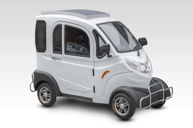 Boomerbuggy XS comes with heating, air conditioning, and solar power panels that trickle charge your scooter while it's outside.
