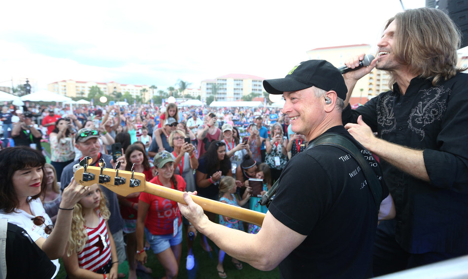 Gary Sinise & The Lt. Dan Band entertain an audience of military veterans and their families during Westgate Resorts' Military Weekend in Orlando.
