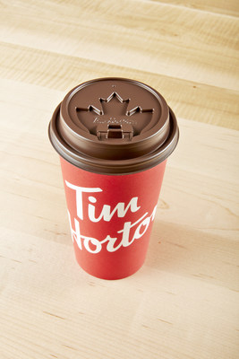 The new Tim Hortons lids have been completely redesigned in both function and design with a raised dome, tabbed closure, an improved flow of coffee and an embossed maple leaf. (CNW Group/Tim Hortons)
