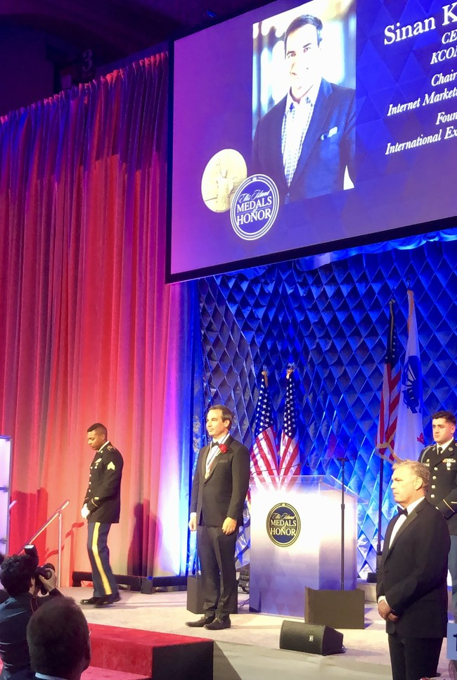 Sinan Kanatsiz, CEO of KCOMM receiving 2019 Ellis Island Medal